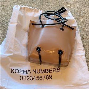 Kozha Numbers small utility bag. Nude.